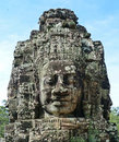 Ancient khmer stone carving of trimurti at bayon arts and architecture the threefold godhead or angkor thom in cambodia Royalty Free Stock Image