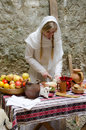 Ancient kitchen young lady preparing food in on traditional way woman in white coat cooking on old fashioned way Royalty Free Stock Photo