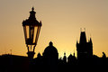 Ancient lamp in prague against sunrise Stock Image