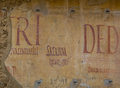 Ancient latin writings in pompeii italy language on the wall of a roman house the archaeological site of campania Royalty Free Stock Photos