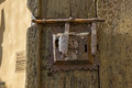 Ancient lock with latch on aged boarded door. Royalty Free Stock Photo