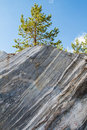 Ancient marble quarry rocks in the wild in the republic of karelia natural stone faults imperial times Stock Photos