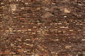 Ancient masonry rough stonework of multi colored bricks in the background Royalty Free Stock Photography
