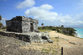 Ancient mayan stone temple at the caribbean cost of tulum mexico Royalty Free Stock Photo