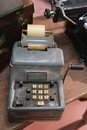 Ancient mechanical calculator manual with worn keys Royalty Free Stock Photo