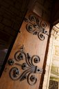 Ancient medieval door iron deco a photograph showing a beautiful wooden decorated with floral elements the massive is the entrance Stock Image