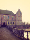 Ancient medieval stone fortress surrounded by water channel, castle Vorden, Netherlands, Europe Royalty Free Stock Photo