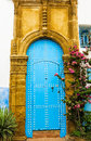 Ancient moroccan art craftsmanship blue door with nail ornament Royalty Free Stock Image