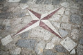 Ancient mosaic stone wind rose pattern pavement with Royalty Free Stock Image