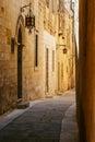 Ancient narrow maltese street in mdina with old lantern Stock Photos