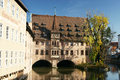 Ancient nuremberg heilig geist spital franconian building overlooking river pegnitz in Stock Photography