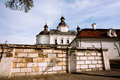 Ancient orthodox church behind the brick white fence in eastern europe on a sunny day Stock Photo