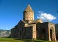 Ancient orthodox stone monastery in armenia tatev monastery made of gray brick beautiful landscape sunny day deep blue sky with Stock Photos