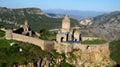Ancient orthodox stone monastery in armenia tatev monastery made of gray brick beautiful landscape sunny day deep blue sky with Royalty Free Stock Photo