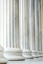 Ancient pillars in the row in an greek building athens greece Stock Photos