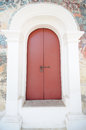 Ancient red door with old painting background Royalty Free Stock Photo