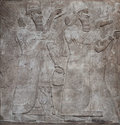 Ancient relief of assyrian gods Royalty Free Stock Image