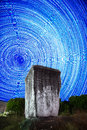 Ancient Rock n the background startrails Royalty Free Stock Photo