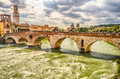Ancient roman bridge called ponte di pietra in verona above the adige river italy Royalty Free Stock Photos