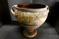 Ancient roman ceramic container a beautiful piece of historic art in the form of a era clay bowl with two handles and raised stand Royalty Free Stock Photo
