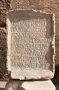 Ancient roman epigraph inscription located in colosseum arena roma italy Stock Photos