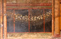 Ancient roman fresco detail of the third style of decorative in a luxury villa symmetrical panels framed by ionic columns and Stock Image