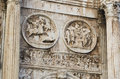 Ancient roman sculptures a close up view of a set of located at the facade of an wall at the forum rome italy Stock Photo