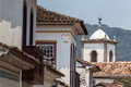 Ancient roofs with an old church tower in the background paraty rj brazil Royalty Free Stock Photo
