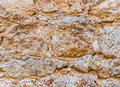Ancient roughness stone wall.  Stonework of sandstone. Peach texture. Royalty Free Stock Photo