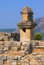 Ancient ruins the lycian tomb on a pillar pedestal in xanthos turkey Royalty Free Stock Photos