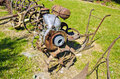 Ancient rusted agriculture tools collection in farm garden Royalty Free Stock Photo