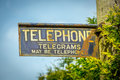 Ancient telephone sign Royalty Free Stock Photo
