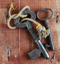 Ancient rusty keys on grunge wood background Royalty Free Stock Images