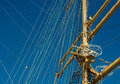 Ancient sailboat masts and the rigging of on sky background exterior of old tall ship Stock Photography