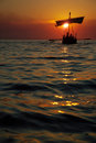 Ancient Sailboat at Sunset Stock Image