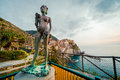 Ancient sculpture and view of Manarola Stock Photos
