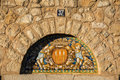 Ancient Spanish decorative ceramics arch on an old facade Royalty Free Stock Photo