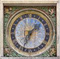 Ancient square wall clock decorated Royalty Free Stock Photography