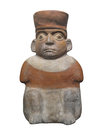 Ancient statue aztec man isolated mesoamerican clay figure of a sitting wearing a hat on white Royalty Free Stock Photo