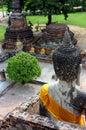 Ancient statues of buddha sitting, at Wat Yai Chaimongkol at Ayutthaya National Park, Thailand.