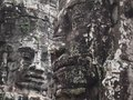 Ancient stone Buddha face closeup.