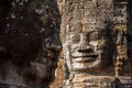 Ancient stone face of Bayon temple Royalty Free Stock Photo