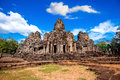 Ancient stone faces of Bayon temple, Angkor Wat, Siam Reap. Royalty Free Stock Photo