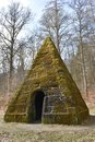 Ancient stone pyramid with moss in the forest on the way to the World Cultural Heritage Herkules in Kassel, Wilhelmshöhe, Germany