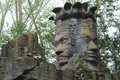 Ancient stone statue twin faces old temple indonesia Stock Image