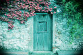 Ancient stone wall and a wooden closed door Royalty Free Stock Photo