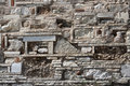 Ancient stonewall background made of pieces of bricks stones tiles amphoras vessels Stock Photos