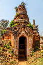 Ancient stupas at indein overgrown with plants inle lake myanmar Stock Image