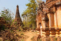 Ancient stupas at indein overgrown with plants inle lake myanmar Stock Photos
