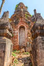 Ancient stupas at indein overgrown with plants inle lake myanmar detail of the entrance Royalty Free Stock Photo